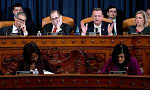 House panel approves charges, Trump at brink of impeachment