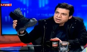 PPP, PML-N slam Faisal Vawda for using a boot to ridicule opposition on TV