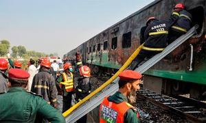 Wooden rail sleepers 'scrap' burnt in Gujranwala