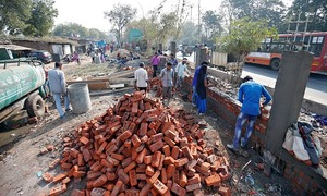 A wall is being built in India's Ahmedabad to block a slum from Trump's view