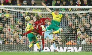 Unbeaten Liverpool 25 points clear after winning at Norwich
