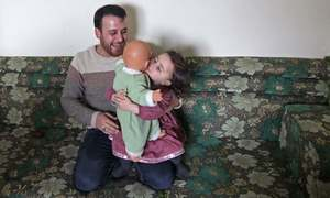 Dealing with trauma: Syrian father teaches 3-year-old daughter to laugh every time a bomb falls