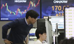 World markets slip on renewed fears over virus outbreak