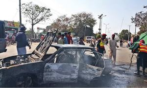 Timely help by locals saves family trapped in burning car