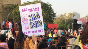 Women peacefully put up Aurat March posters. They were violently torn down soon after