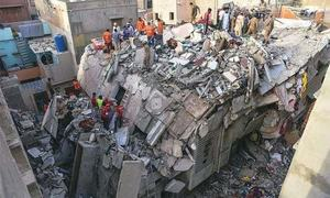 Karachi building collapse: death toll rises to 27 as authorities retrieve more bodies