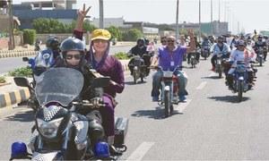 Women bike across Karachi for International Women's Day