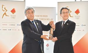 Olympic flame passed to Fukushima during ceremony