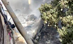 97 killed as plane crashes into residential area near Karachi airport
