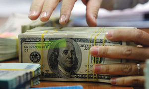 Reserves down on $1.7bn debt payments