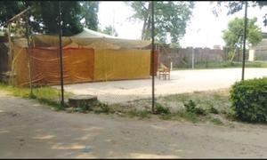 Open-air jail for face mask violators in Daska