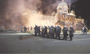 Serbia mulls scrapping curfew after violent protests