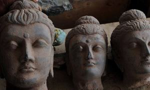 Police arrest 4 men for destroying ancient Buddha statue found during construction in Mardan