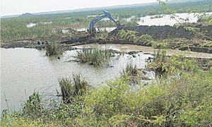 Four booked for attempt to grab portion of Keenjhar's Ramsar site