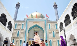 In pictures: Hopes and prayers as Lal Shahbaz Qalandar's shrine welcomes visitors after five months