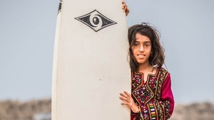 Surf's up for 9-year-old Venus Baloch
