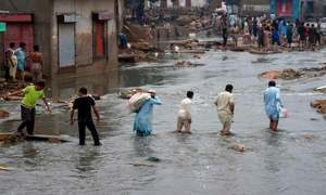 In pictures: Torrential rain floods Karachi, shatters records