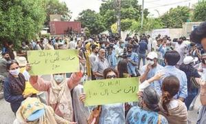Residents protest outside DHA office in Karachi, demand to be heard