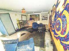 Artist loses thousands of works to flooding