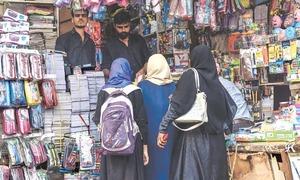 Shopping frenzy in Urdu Bazaar on eve of schools' reopening
