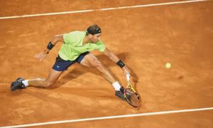 Nadal stunned, Djokovic battles into Italian Open semis