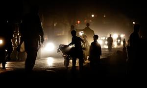 Karachiites endure power cuts in stifling heat as KE, SSGC play blame game