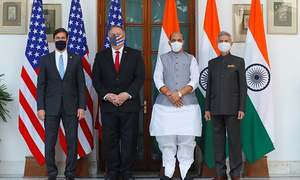 US warns of threat posed by China, signs military pact with India