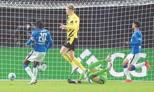 Haaland scores four as Dortmund trim Bayern's lead