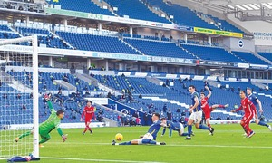 Late penalty leaves Liverpool with draw at Brighton