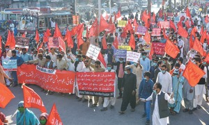 Workers' rally slams govt's policies, seeks end to 'protection of major investors'
