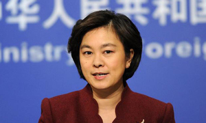 China defends handling of initial stage of Covid-19 outbreak
