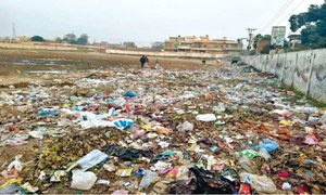 College playground garbage plagues residential area
