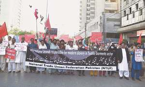 Workers hold rally for basic rights, better conditions