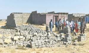 Scores of houses razed, many others marked to make way for Malir Expressway