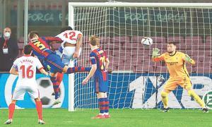 Barca reach Copa final with comeback win over Sevilla