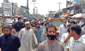 Swabi traders protest fines, sealing of shops