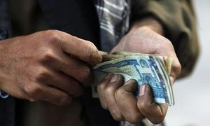 Turbulence in Afghanistan sends its currency tumbling