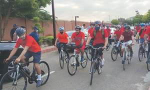 Doctors go on early morning bicycle ride to promote healthy lifestyle