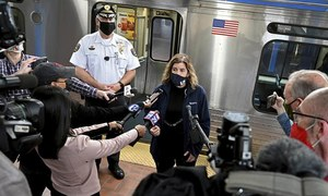 Train riders in US held up phones as woman was raped, police say