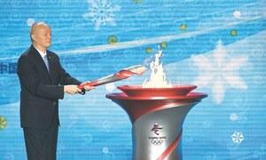 Beijing lights Olympic flame amid boycott calls