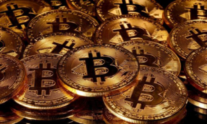Bitcoin hits record above $66,000 on Wall Street debut