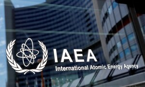 France urges Iran to curb nuclear activity, resume talks